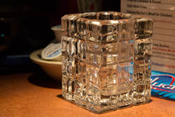 I took my camera to a restaurant and found a pretty candle holder