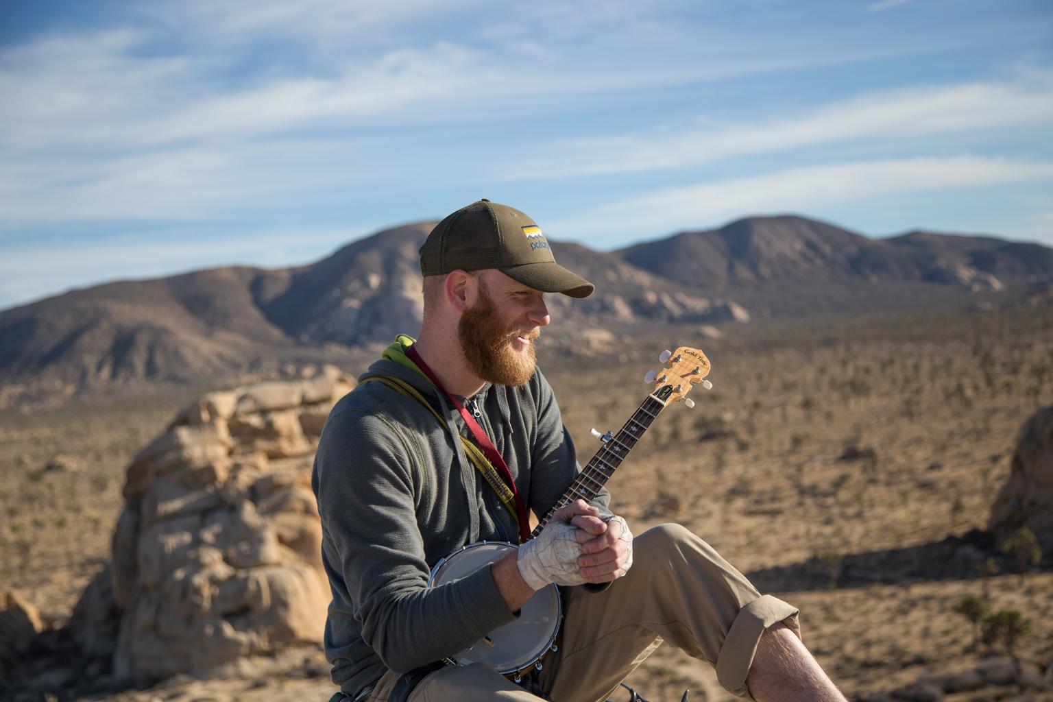 Craig playing banjo on top of Chimney Rock, Joshua Tree