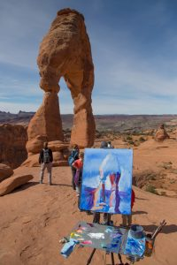 Painting Delicate Arch, building on a blue monotone base